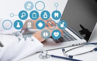 Medical doctor using laptop. Several icons overlaid on top of image, including healthcare, technology, hospital, and medicine.