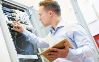 Network engineer administrator checking server hardware equipment of data center