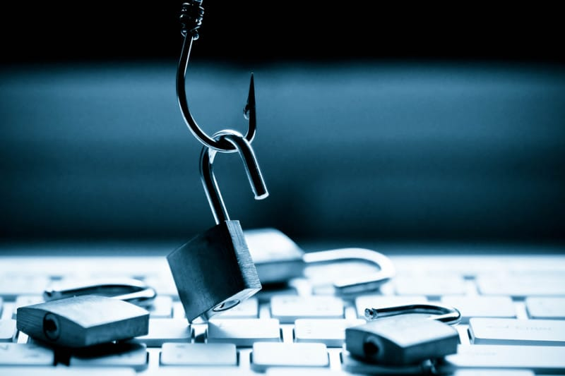 Lock hanging on hook over keyboard - Computer threat phishing attack on computer system