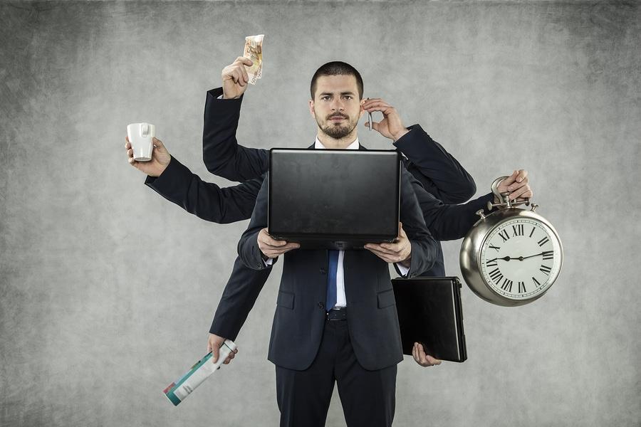 Businessman is a multitasking person in IT Management