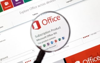 Microsoft Office 365 on the web under magnifying glass. Showcasing applications such as Word, Excel, PowerPoint, and Outlook