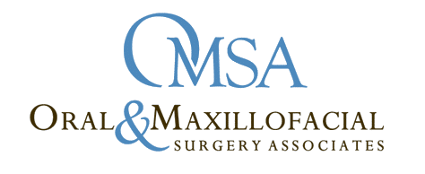 Black and blue logo of OMSA Oral & Maxillofacial Surgery Associates