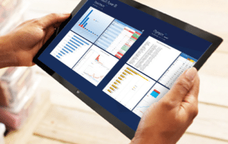 Tablet displaying Microsoft Power BI data