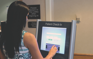 Woman using check in kiosks built by Biz Technology Solutions at Hugh Chatham Memorial Hospital