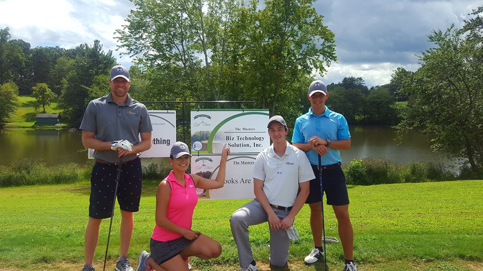 Group shot of BTS employees at the Hugh Chatham Memorial Hospital Charity Foundation Golf Tournament