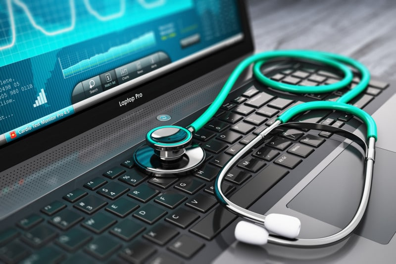 Cybersecurity Threats Healthcare - laptop computer with medical diagnostic software and stethoscope